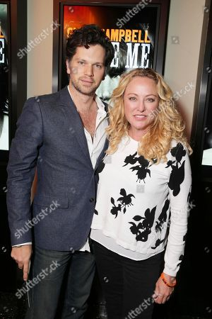 Nick Holmes and Virginia Madsen seen at Los Angeles Premiere of 'Glen Campbell: I'll be Me', in Los Angeles, CA