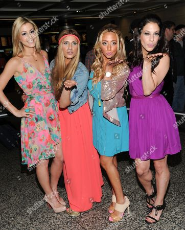 """The cast of Bravo's """"Princesses: Long Island"""", from left, Casey Cohen, Chanel """"Coco"""" Omari, Amanda Bertoncini, and Joey Lauren pose together at Penn Station before they embark for The Hamptons on in New York"""