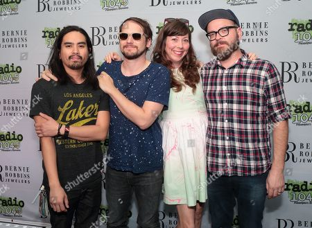 Chris Guanlao, from left, Brian Aubert, Nikki Monninger and Joe Lester of Silversun Pickups pose for photographers backstage during night 2 of the Radio 104.5 9th Birthday Show at BB&T Pavilion, in Camden, N.J