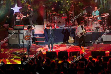 Top left, counter-clockwise, artists Warren Ham, Todd Lukather, Ringo Starr, Richard Page and Gregg Bissonette perform at the Ryman Auditorium, in Nashville, Tenn