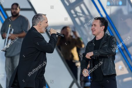 Stock Picture of Miguel Bose, left, and Juan Fernando Fonseca perform at RiseUp As One at Cross Border Xpress, in San Diego