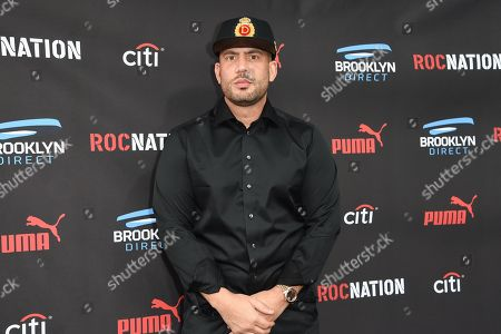 DJ Drama arrives at the Roc Nation Pre-Grammy Brunch at RocNation Offices, in Beverly Hills, Calif