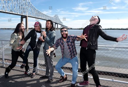 Matt DiRito, from left, Dave Grahs, Leigh Kakaty, Joshua Marunde and Nick Fuelling of the band Pop Evil pose for a portrait before the Rock Allegiance Festival at PPL Park, in Chester, Pa