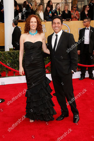 Oscar Nunez (right) and Ursula Whittaker arrive at the 19th Annual Screen Actors Guild Awards at the Shrine Auditorium in Los Angeles on