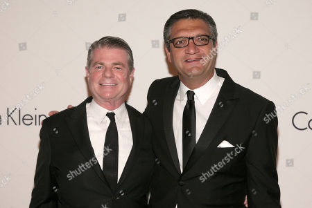Stock Picture of Calvin Klein, Inc. CEO Tom Murry, left, and PVH Corporation Chairman and CEO Manny Chirico, right, attend the Save The Children Benefit Gala, in New York