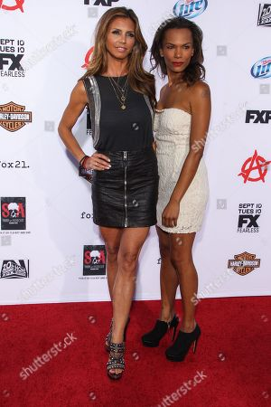 """From left, actresses Charisma Carpenter and Amber Dixon arrive at the season 6 premiere screening of """"Sons of Anarchy"""" at the Dolby Theatre on in Los Angeles"""