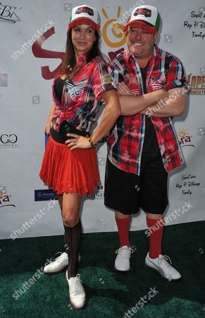 Debbe Dunning, at left, and Gary Valentine arrive at the Seventh Annual George Lopez Celebrity Golf Classic at Lakeside Golf Club, in Toluca Lake, Calif