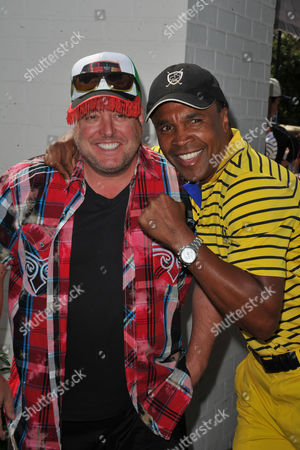 Gary Valentine, at left, and Sugar Ray Leonard arrive at the Seventh Annual George Lopez Celebrity Golf Classic at Lakeside Golf Club, in Toluca Lake, Calif