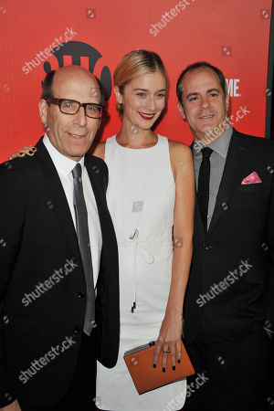 Stock Photo of Matt C. Blank, from left, Caitlin Fitgerald, and David Nevins arrives at the Showtime Primetime Emmy's Eve Party at the Sunset Tower on in Los Angeles