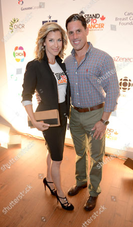 Carolyn MacKenzie, left, and Chris Stark attend Stand Up To Cancer Canada, in Toronto