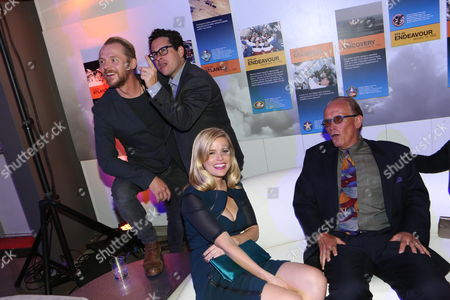 "IMAGE DISTRIBUTED FOR PARAMOUNT PICTURES - From background left, Simon Pegg, J.J. Abrams, Alice Eve, and Peter Weller gather at the ""Star Trek Into Darkness"" home entertainment launch party on Tuesday, Sept, 10, 2013 at the California Science Center in Los Angeles"