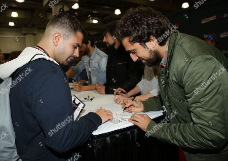 """Gregg Chillin, from the STARZ television show """"Da Vinci's Demons"""", signs autographs for fans during New York Comic Con on in New York"""