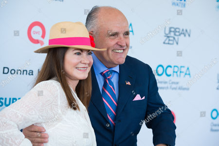 """Judith Giuliani, left, and Rudy Giuliani attend the Ovarian Cancer Research Fund Allianceâ?™s (OCRFA) 19th annual """"Super Saturday"""" garage sale benefit at Nova's Ark Project in Water Mill, in New York"""