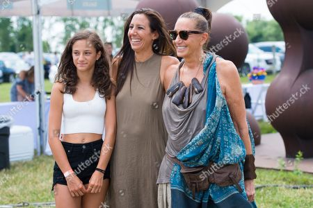 """Stock Image of Stefania de Felice, left, Gabby Karan de Felice, middle, and Donna Karan attend the Ovarian Cancer Research Fund Allianceâ?™s (OCRFA) 19th annual """"Super Saturday"""" garage sale benefit at Nova's Ark Project in Water Mill, in New York"""