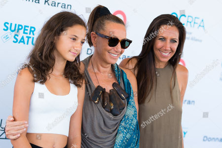 """Stefania de Felice, left, Donna Karan, middle, and Gabby Karan de Felice attend the Ovarian Cancer Research Fund Allianceâ?™s (OCRFA) 19th annual """"Super Saturday"""" garage sale benefit at Nova's Ark Project in Water Mill, in New York"""