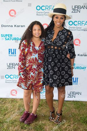 "Summer Chamblain, left, and June Ambrose attend the Ovarian Cancer Research Fund Alliance's (OCRFA) 19th annual ""Super Saturday"" garage sale benefit at Nova's Ark Project in Water Mill, in New York"