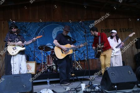 Scott Mecredy (L) and Jason Kenney (R) sit in as Ralph Roddenberry performs at the Suwannee Springfest at the Spirit of Suwannee Music Park, on in Live Oak, Florida