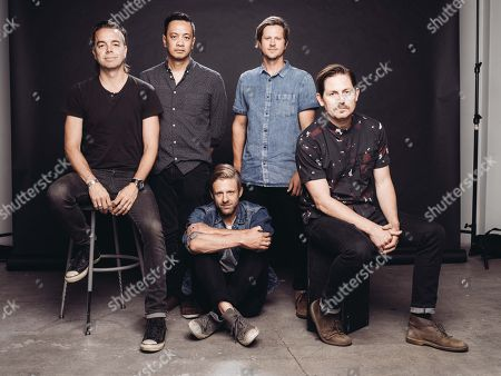 Drew Shirley, from left, Jerome Fontamillas, Jon Foreman, Tim Foreman and Chad Butler of Switchfoot pose for a portrait at Savant Studios on in Los Angeles