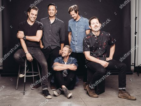 Stock Picture of Drew Shirley, from left, Jerome Fontamillas, Jon Foreman, Tim Foreman and Chad Butler of Switchfoot pose for a portrait at Savant Studios on in Los Angeles