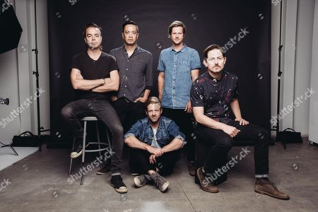 Stock Image of Drew Shirley, from left, Jerome Fontamillas, Jon Foreman, Tim Foreman and Chad Butler of Switchfoot pose for a portrait at Savant Studios on in Los Angeles