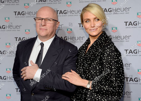 Tag Heuer CEO, Stephane Linder and actress Cameron Diaz pose together at the Tag Heuer flagship store opening, in New York