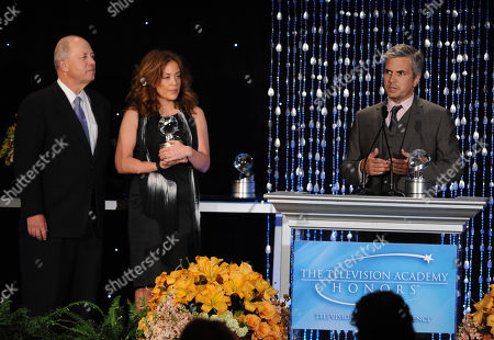 """Stock Photo of Susie Fogelson (center) of The Food Network and Dan Cutforth (right) of Magical Elves accept the Academy Honor award for """"Hunger Hits Home"""" from presenter, CEO of Share Our Strength Billy Shore onstage at the Academy of Television Arts & Sciences Presents """"The 6th Annual Television Honors"""" at the Beverly Hills Hotel on in Beverly Hills, California"""