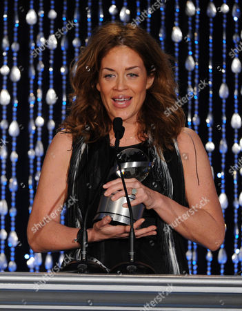 """Stock Image of Susie Fogelson of The Food Network accepts the Academy Honor award for """"Hunger Hits Home"""" onstage at the Academy of Television Arts & Sciences Presents """"The 6th Annual Television Honors"""" at the Beverly Hills Hotel on in Beverly Hills, California"""