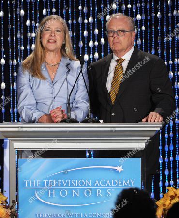 """Co-Chairs of the Television Cares Committee Lynn Roth (left) and John Shaffner speak onstage at the Academy of Television Arts & Sciences Presents """"The 6th Annual Television Honors"""" at the Beverly Hills Hotel on in Beverly Hills, California"""