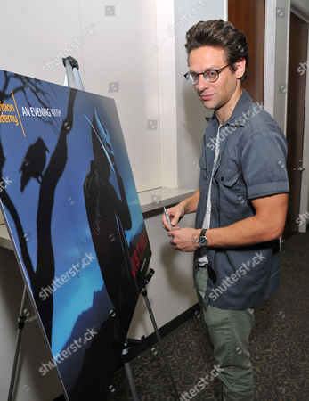 """Jacob Pitts signs a poster at """"An Evening with Justified,"""", at the Television Academy in the NoHo Arts District in Los Angeles"""
