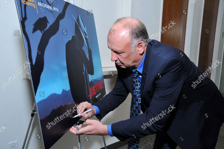 """Nick Searcy signs a poster at """"An Evening with Justified,"""", at the Television Academy in the NoHo Arts District in Los Angeles"""