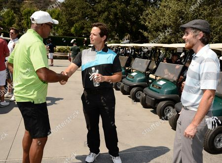 From left, Rocky Carroll, Scott Wolf, and Dave Annable arrive at the Academy of Television Arts & Sciences 14th Primetime Emmy Celebrity Tee-Off, on Monday, September, 9, 2013 at Oakmont Country Club in Glendale, CA