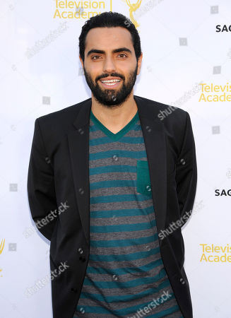 Farshad Farahat seen at the Television Academy's 66th Emmy Awards Dynamic and Diverse Nominee Reception at the Television Academy, in the NoHo Arts District in Los Angeles