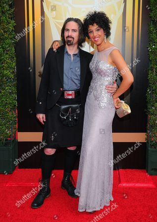 Bear McCreary, left, and Raya Yarbrough arrive at the Television Academy's Creative Arts Emmy Awards at Microsoft Theater, in Los Angeles