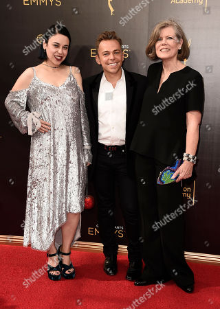 Jennifer Salim, from left, Paolo Nieddu, and Mary Lane arrive at night one of the Television Academy's 2016 Creative Arts Emmy Awards at the Microsoft Theater on in Los Angeles