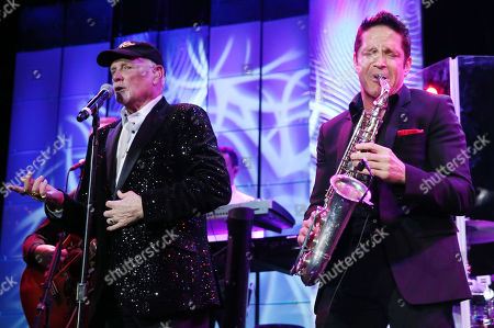 Dave Koz, right, and Mike Love perform at The Society of Singers' 21st ELLA Awards on in Beverly Hills, Calif. The event honored Mike Love, lead singer and co-founder of The Beach Boys, producer Nigel Lythgoe, and backup singers The Waters Family