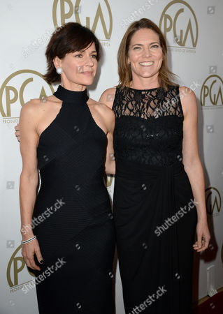 Kristine Belson and Jane Hartwell arrive at the 25th annual Producers Guild of America (PGA) Awards at the Beverly Hilton Hotel, in Beverly Hills, Calif