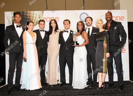 Stock Photo of Alfred Enoch, from left, Karla Souza, Jack Falahee, Katie Findlay, Matt McGorry, Aja Naomi King, Charlie Weber, Liza Weil, and Billy Brown poses in the press room with the award for outstanding drama series for How to Get Away with Murder at the 46th NAACP Image Awards at the Pasadena Civic Auditorium, in Pasadena, Calif