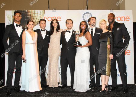 Alfred Enoch, from left, Karla Souza, Jack Falahee, Katie Findlay, Matt McGorry, Aja Naomi King, Charlie Weber, Liza Weil, and Billy Brown poses in the press room with the award for outstanding drama series for How to Get Away with Murder at the 46th NAACP Image Awards at the Pasadena Civic Auditorium, in Pasadena, Calif