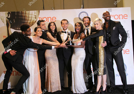 Stock Image of Alfred Enoch, from left, Karla Souza, Jack Falahee, Katie Findlay, Matt McGorry, Aja Naomi King, Charlie Weber, Liza Weil, and Billy Brown poses in the press room with the award for outstanding drama series for â?oeHow to Get Away with Murderâ?? at the 46th NAACP Image Awards at the Pasadena Civic Auditorium, in Pasadena, Calif