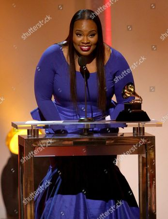 """Tasha Cobbs accepts the award for best gospel/contemporary christian music performance for """"Break Every Chain [LIVE]"""" at the pre-telecast of the 56th annual GRAMMY Awards, in Los Angeles"""