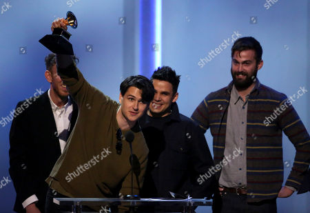 """From left, Ezra Koenig, Rostam Batmanglij and Chris Tomson, of Vampire Weekend, accept the best alternative music album award for """"Modern Vampires Of The City"""" at the pre-telecast of the 56th annual GRAMMY Awards, in Los Angeles"""