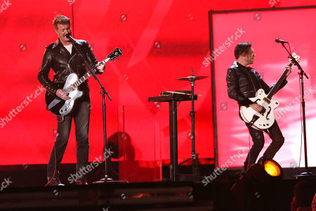 Joshua Homme, left, and Trent Reznor perform on stage at the 56th annual GRAMMY Awards at Staples Center, in Los Angeles