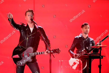 Joshua Homme, left, performs on stage at the 56th annual GRAMMY Awards at Staples Center, in Los Angeles