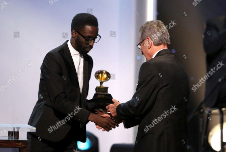 """Tye Tribbett, left, presents the best surround sound album award to Al Schmitt for """"Live Kisses"""" at the pre-telecast of the 56th annual GRAMMY Awards, in Los Angeles"""