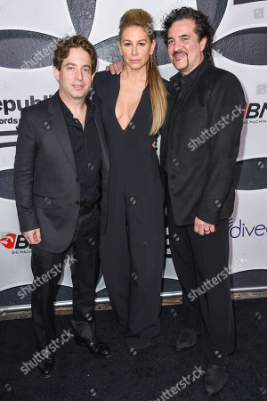 Charlie Walk, left, Jennifer Fisher and Scott Borchetta arrive at Republic Records & Big Machine Label Group Private Celebration After Party at The Warwick, in Los Angeles