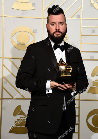 "Stock Picture of Dave Aude poses in the press room with the award for best remixed recording, non-classical for ""Uptown Funk (Dave Aude Remix)"" at the 58th annual Grammy Awards at the Staples Center, in Los Angeles"