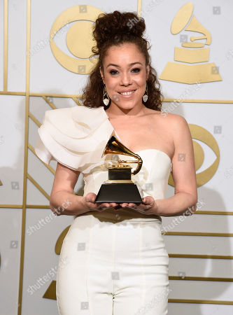 Kendra Foster poses in the press room with the award for best R&B song for Really Love at the 58th annual Grammy Awards at the Staples Center, in Los Angeles