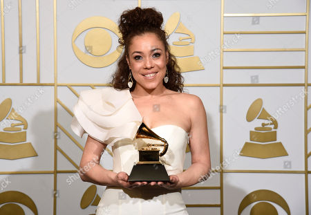 Stock Photo of Kendra Foster poses in the press room with the award for best R&B song for â?oeReally Loveâ?? at the 58th annual Grammy Awards at the Staples Center, in Los Angeles
