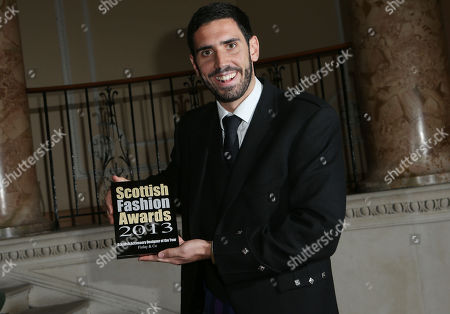 Dave Lochhead holds the Accessory Designer of the Year Award at the 8th Annual Scottish Fashion Awards 2013 dinner, celebrating Scotland's fashion talent, at Dover House, in central London, as part of a Scottish fashion invasion of London