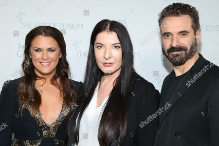 Founder of The Art of Elysium, Jennifer Howell, Art of Elysium Creative Visionary, Marina Abramovic and Creative Director of Costume National, Ennio Capasa arrive at The Art Of Elysium Heaven Gala at Hangar 8 on in Santa Monica, CA